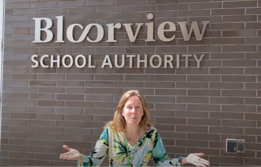 Principal standing in front of Bloorview school.